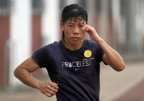 Indian woman boxer MC Mary Kom warms up during a training session at the Balewadi Sports Complex in Pune, about 180 km (112 miles) from Mumbai on April 19, 2012, ahead of the 2012 Olympics which will be held in London (via Photo from Getty Images)