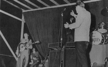 George Harrison enters as Red Robinson introduces the Beatles at Empire Stadium, Vancouver  - Aug. 22, 1964