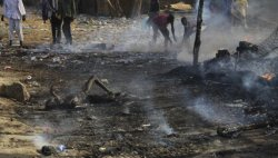 #Sudan +18 A burned body lies amidst the smouldering remains of a market in Rubkona near Bentiu in South Sudan Monday, April 23. Photo By Michael Onyiego , AP