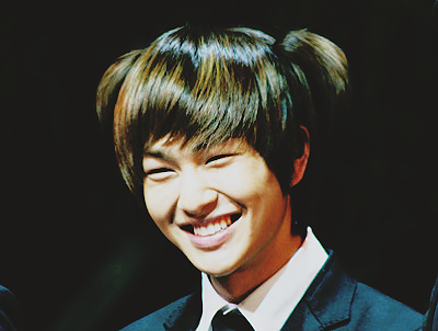 I think Onew is cuter without eye makeup.
