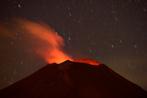 Popocatepetl gives a spectacular display in the Mexican central state of Puebla, but residents at the foot of the volcano can no longer sleep soundly since it erupted back into action more than a week ago, spewing out a hail of rocks, steam and ashes Photograph: Ronaldo Schemidt/AFP/Getty Images