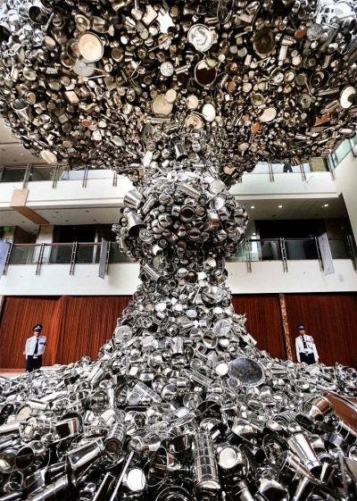 An installation made of steel utensils in the shape of a giant mushroom cloud refers to the dust-cloud of atomic bombings of Hiroshima and Nagasaki, in New Delhi, India. (Kevin Frayer/Associated Press) Line of Control by Subodh Gupt