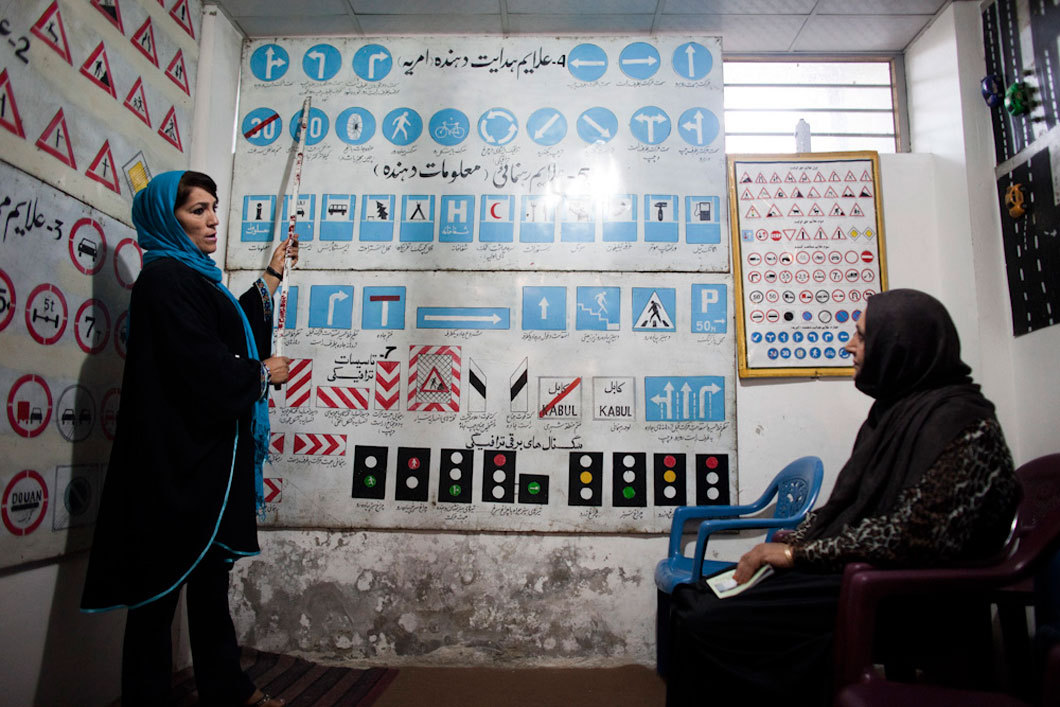 Shaquila Naderi (left), a driving school teacher, during a lesson in Kabul, Afghanistan. Naderi, the only female driving instructor in Kabul, teaches several classes a day, mostly to women. Photo: Jonathan Saruk The war in Afghanistan is not over. Help us tell the story. Fund our Kickstarter.