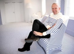 There is only one 60 year old man who can wear a jumper to match the sofa he is sitting on without being questioned or labelled a little bit cuckoo, but be worshipped for it instead. It helps if you're name is Jean Paul Gaultier, too. Yep, the old French master of haute couture turns 60 today and is still looking way too good for his age, still setting trends with his designs and still smiling about it all - he obviously doesn't take public transport in the morning.   Yipiii is celebrating Monsieur Gaultier's with a blog entry from our very own culture vulture, GioAT, basking in glory of such an esteemed creative mind. We suggest you check it out and have a read, but don't recommend the matching sofa/sweater look. Don't. Really, just don't.