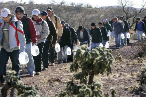 latimes:  Report finds wave of Mexican immigration to U.S. has ended: The study by the Pew Hispanic Center cites the economic downturn and increased enforcement at the U.S.-Mexico border as factors in the drop in the number of Mexicans coming to the country. Photo: Migrants thread their way along footpaths just north of the Mexico-Arizona border in 2007. A new report says immigration from Mexico has come to a statistical standstill. Credit: Don Bartletti / Los Angeles Times