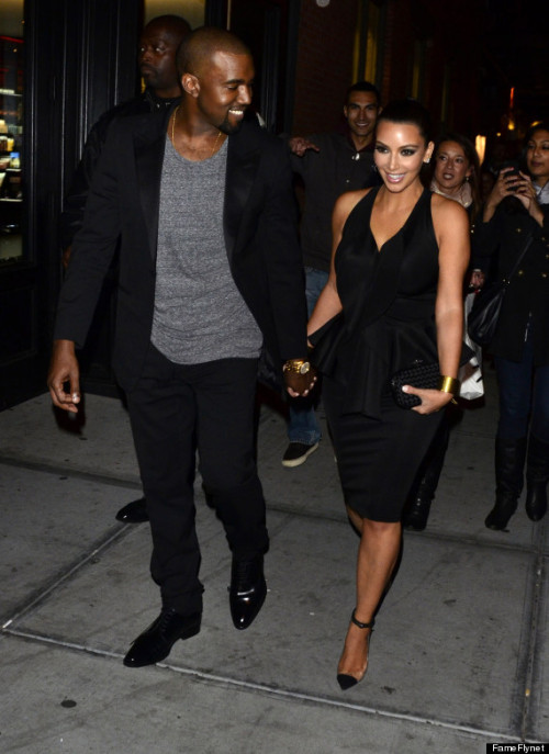 Kim Kardashian and Kanye West holding hands….so fitidogurous