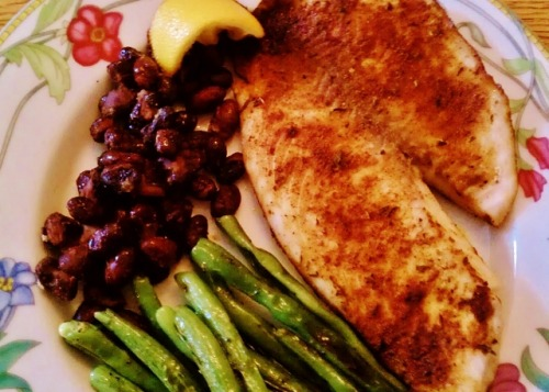 Spicy Tilapia and Beans Tilapia Fresh Green Beans (about 10) Black Beans (about 1/4 cup) Spices (Paprika, Thyme, Salt, Pepper, Cayenne Pepper, Celery Seed and Oregano) Lemon and Lime  Preheat oven to 375 Combine seasonings:- 1 tsp paprika- 1/4 tsp black pepper- 1/8 tsp cayenne pepper- 1/8 tsp oregano- 1/8 tsp thyme- 1/8 tsp salt- dash celery seed  Sprinkle seasonings over both sides of fish.  Coat oven safe pan in oil, place in fish, squeeze in 1/4 fresh lemon Cook fish for half an hour (or to liking) at 375. If you want it more done, place under broiler for the last 5 minutes. Take of ends of green beans, steam (put water in pan) over medium high heat until slightly soft. Take out water and add EVOO, S&P and cook until lightly browned. Saute black beans (on medium high heat) with about 1 tbsp lime juice and sprinkle with cayenne pepper. Cook until warmed.