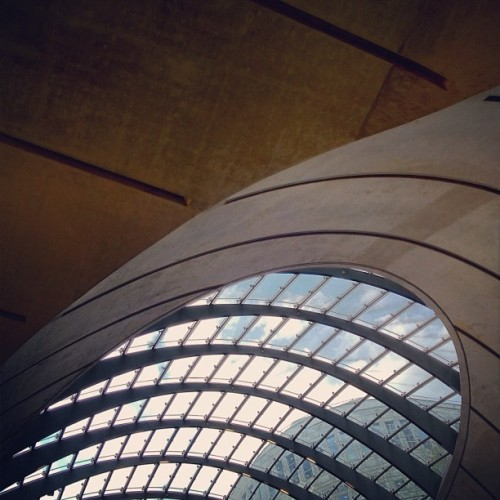 Under the fingernail #canarywharf #tubestation #jubileelineextention #jubileeline #2000 #concrete #glass #panels #steel #hood #mainentrance #eastlondon #london #england #greatbritain #unitedkingdom #subway #londontransport #TfL #thetube #architecture #cathedralofcommuting #bluesky #whitecloud. #structure #dock #quay (Taken with Instagram at Canary Wharf Underground station)