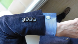 Kissing buttons. Cufflink looks comfy with those!