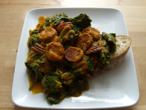 Lunch!  vegan chipotle sausage and spinach cooked in a reduced carrot soup with pecans over crisp batard
