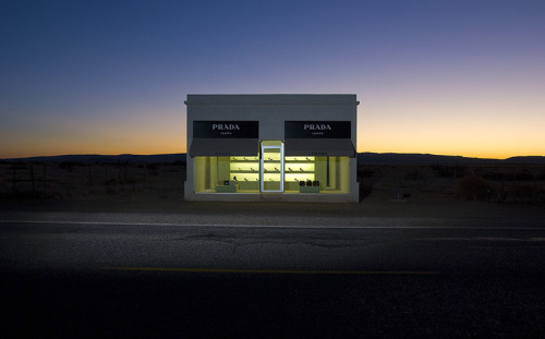 youmightfindyourself:  Elmgreen and Dragset's 'Prada Marfa' Built in 2005 near the West Texan towns of Valentine and Marfa, 'Prada Marfa' is a permanent sculpture created by artist-collaborators Michael Elmgreen and Ingar Dragset. Masquerading as a Prada mini-boutique, the sculpture's door is in fact non-functioning. Instead the building is intended to never be used and never repaired. For the artists, the hope is that over time, the piece will slowly degrade back into the natural landscape. (via The Fox is Black)