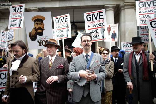 tallthegreedy:  People in suits hold a protest against a planned Abercrombie & Fitch store on Savile Row, London  I Agree.  Now this is my sort of protest. No unwashed ruffians. Everyone dressed smartly. And how wonderful - Mr B, the Gentleman Rhymer is there with his banjolele.