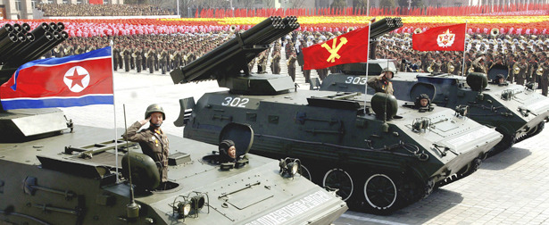 "North Korea Thanks Its Schoolchildren For Building Such Nice Rocket Tanks  North Korea's official propaganda outlet, the Korean Central News Agency, recently declared the state's appreciation for all those young school kids who ""helped"" manufacture rocket-shooting tanks for the People's Army. The announcement, which coincided with a military parade in the country's second-largest city to show off the vehicles, also thanked the ""Democratic Women's Union"": Multiple-launch rocket systems ""Sonyon-ho"" and ""Nyomaeng-ho"" manufactured with the assistance of school youth and children and members of the Democratic Women's Union of Korea (DWUK) across the country were presented to units of the Korean People's Army (KPA) with due ceremony at Hamhung Square in South Hamgyong Province on Thursday to mark the 80th anniversary of the KPA. Those rockets are associated with their will to remain true to the Party's Songun revolutionary leadership generation after generation and their patriotic desire to make contributions to bolstering the nation's defence capability.  Multiple-launch rocket systems (MLRS, in military parlance) are serious pieces of equipment, meant to fire guided or unguided explosives over dozens or miles. That they were apparently built in part by school-aged kids is a reminder that North Korean society is so militarized — and so exploited — that even children are skilled and practiced at constructing sophisticated mechanical and electronic weaponry. That the state would actually boast its use of child labor for building tanks is a reminder of the extent to which military nationalism has twisted North Korean society.  Read more. [Image: KNCA/Reuters]"