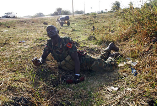 thepoliticalnotebook:  Picture of the Day: Rubkona, South Sudan. April 23rd. This stunning captured moment shows a Sudan People's Liberation Army (SPLA) soldier taking cover as Sudanese warplanes carry out airstrikes against the newly independent South Sudan. Rubkona is near the southern oil town Bentiu, where three people died on Monday.  Check out: Some other unbelievable photography from the Sudanese conflict, many by the very talented Goran Tomasevic. Credit: Goran Tomasevic/Reuters. Via. View more Picture of the Day posts. Submit a photo.