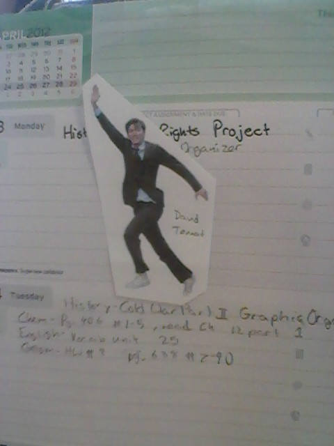 So, last week I brought my David Tennant as the Doctor action figure to school with me and I decided to show my friends this blog. Needless to say they approved.  Today in lunch my friend opened her organiser and showed us this and preceded to hand out little cut outs of him to everyone at the table.  (From: VanHelsingFreak)