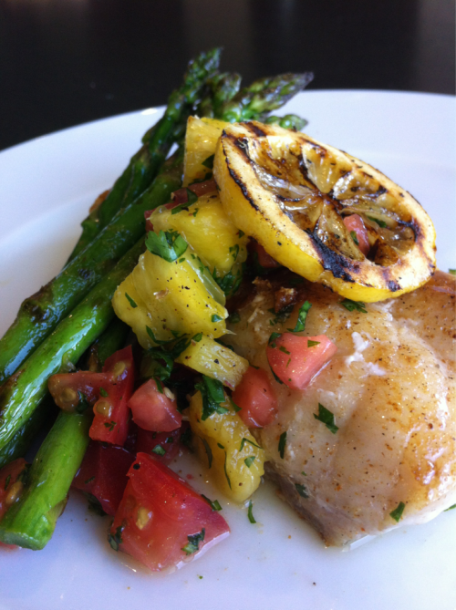 Pan Seared Grouper topped w/ pineapple salsa & side cured grilled asparagus. #NolaChef