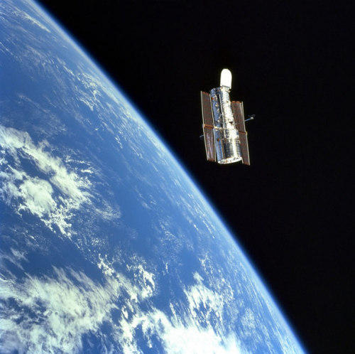 the-star-stuff:  Happy 22nd, Hubble! Today is the 22nd anniversary of the launch of the Hubble Space Telescope.  On April 24, 1990, the Space Shuttle Discovery roared into space, carrying on board a revolution: The Hubble Space Telescope. It was the largest and most sensitive optical-light telescope ever launched into space, and while it suffered initially from a focusing problem, it would soon return some of the most amazing and beautiful astronomical images anyone had ever seen. CLICK!! Ten Things You Don't Know About Hubble.