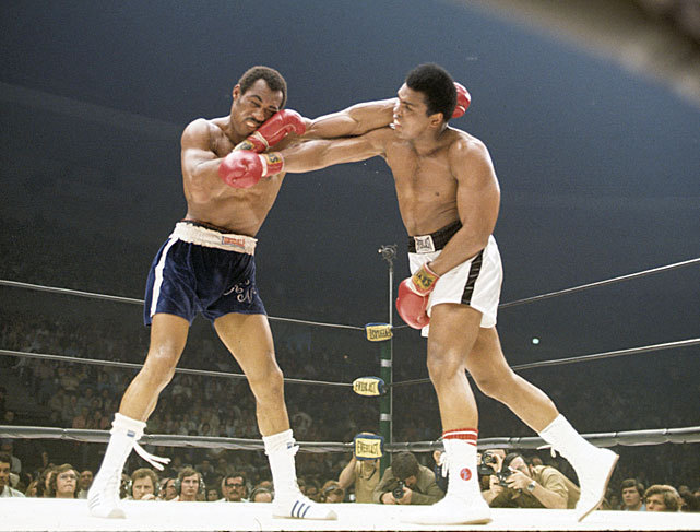 Muhammad Ali and Ken Norton exchange blows during their 1973 fight in San Diego, the first of their three bouts against one another. Ali would wind up losing a 12-round decision after Norton broke his jaw early in the fight. (Neil Leifer/SI)  SI VAULT: Ali looking for revenge after broken jaw against Norton (4.23.73)GALLERY: Tribute to Muhammad Ali | Ali's Greatest Fights