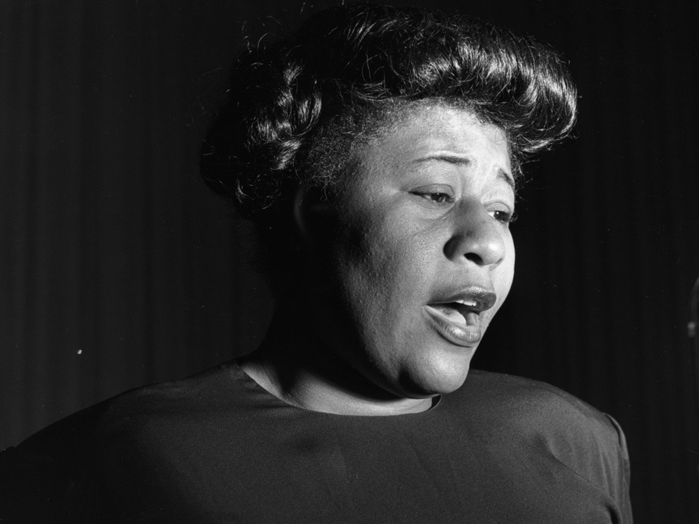 "nprmusic:  Happy birthday, Ella Fitzgerald! The ""First Lady of Song"" would have been 95 years old.  Her voice is instantly recognizable. Her youthful exuberance, pure sound and positive energy just make you feel good. Her incredible technical abilities were self-evident, but when she sang, she radiated a joy consistent with her own character both on and off the bandstand. Download an hour-long documentary about the undisputed queen of jazz, then search our rich Jazz Profiles archive.  Photo: George Konig/Hulton Archive"