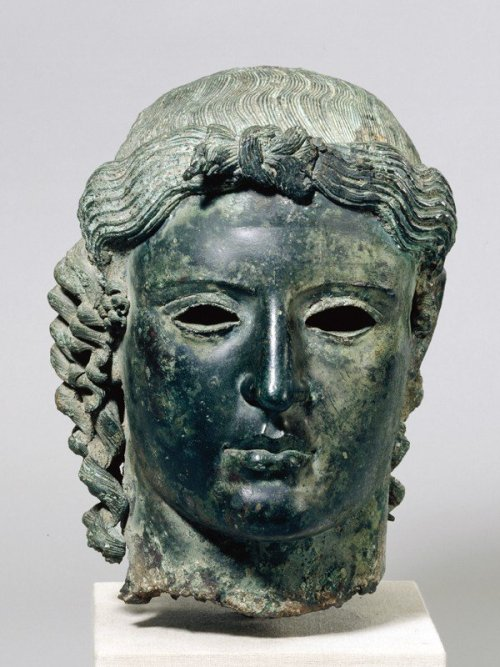"The Chatsworth Head, Ancient Greece, 470 BC-460 BC ""The statue was found complete by peasants in 1836 in the bed of the Pediaeos river north of the village of Politiko (ancient Tamassos) in central Cyprus. The findspot was later revealed by excavation to have been a very important sanctuary dedicated to Apollo. According to the account of the finders preserved in Ludwig Ross's account of his visit to Cyprus in 1845, the statue was naked, with the exception of a wide belt, with the left foot extending forward. The arms, legs and head were cast separately from the body, indicated by the fact thay they broke off as the statue was dragged away from the site.The existence of the belt suggests a more archaic form for the body than the head, whose closest parallels lie in the Severe Style of Greek sculpture in the second quarter of the 5th century BC. The staue was broken up and sold for scrap bronze for a very low price, with the exception of the head which came into the possession of an English collector and dealer who later sold it on to the Duke of Devonshire. Cornelius Vermeule suggests the statue was a cult image similar to that from the temple of Apollo at Miletos and furnishes the origin with arrows or a phiale in one hand and a bow in the other, though this is not certain as cult statues of this kind are very rare on Cyprus"" The British Museum"