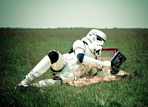 Casually reading a book in a field..