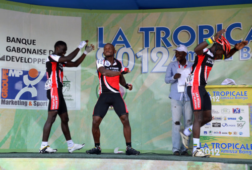 Gabones cyclists Ange Ntzatsi Koumba and Junior Lingoombe Bongo dance on the podium of the first stage of the Tropicale Amissa Bongo cycling race, on April 24, 2012 in Lambarene. AFP PHOTO / PATRICK FORT (via Gabones Cyclists - Yahoo! Sports Photos) Podium dancing = co-mod natalie approved!