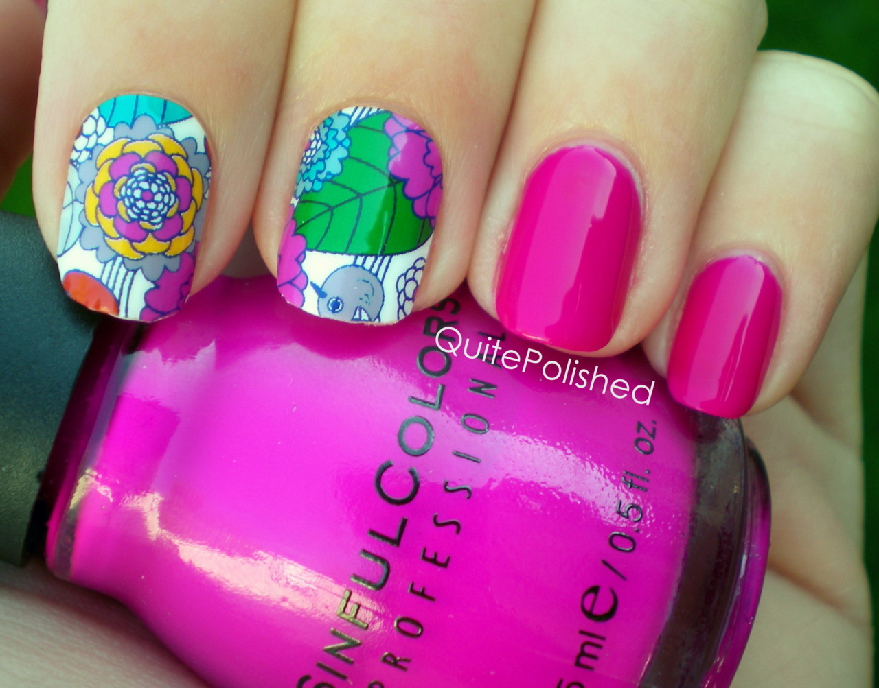 quitepolished:  Jamberry Nail Shields - Spring Flower So Jamberry is kind like Avon with how they have representatives that sell the products, and we have a representative in my town who worked with my school to give out samples to people who bought post prom tickets, and these were the ones that I chose!   I love birds and florals and both are things that I'm scared of even attempting on my nails so I chose the Spring Flower design, which has both! To put these on you warm them up with a hair dryer for 15 seconds then apply to your nail. Then you file off the excess and use the hair dryer again to seal them. It was pretty easy, although I had some problems getting the tips to stay completely smooth on my index fingers. It's nothing too horrible though, and these feel very secure on my nails instead of feeling like foreign objects.  Also shown is three coats of Sinful Colors Dream On.