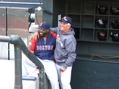Bobby Valentine greets slugger David Ortiz in the dugout during pregame batting practice Tuesday at Target Field.