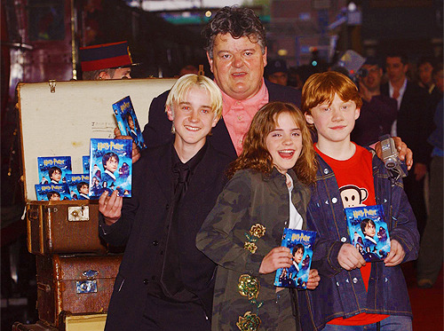 rupertdaily:  Rupert Grint, Emma Watson, Tom Felton and Robbie Coltrane @ HP and the Philosopher's Stone DVD Launch
