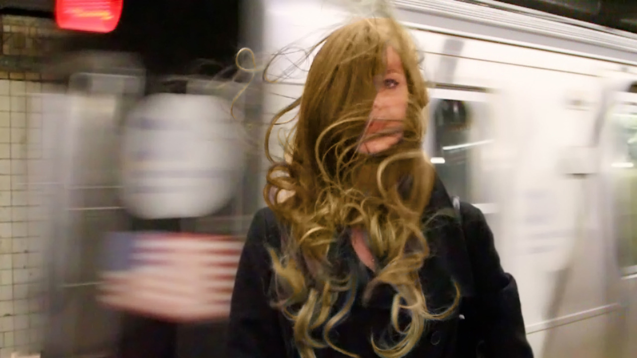 "letmypeopleshow:  The Answer (on the L Train) Is Blowing in the Wind: We all know what it's like to run for the subway doors, only to watch them close and the train pull away, but it took the particular sensibility of Neil Goldberg to turn the experience into an art piece. One of his photo series shows New Yorkers doing just that; another records people choosing salad-bar offerings. ""Subway Trapezoids"" shows the piece of sky you see when you ascend the stairs. These and more, including a video of a wind gust moving through people's hair at the Bedford Avenue stop on the L Train, are in ""Stories the City Tells Itself: The Video Art and Photography of Neil Goldberg,""  the first contemporary-video show at the venerable Museum of the City of New York. To help the artist explain how he transforms seemingly meaningless moments into profound and comical artworks, the museum turned to Maira Kalman, whose delight and empathy for the objects of daily life was so beautifully showcased in her recent Jewish Museum exhibition.  This Thursday, they will both appear in a conversation at the Museum of the City of New York, hosted by Queens Museum director Tom Finkelpearl. The subject is how they make art out of the everyday. Go for the talk—but get there early for treats from Brooklyn's Blue Marble Ice Cream.  Image from Goldberg's single-channel video installation ""Wind Tunnel,"" 2012. Courtesy Museum of the City of New York and the artist.   Beautiful"