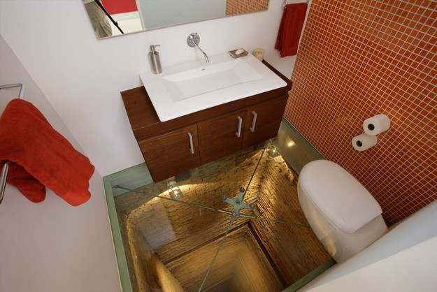 morbi:  itseasytoremember:   Bathroom with glass floor, overlooking a 15 story elevator shaft.  incase peeing was difficult for you  I wouldn't even be able to make it to the toilet good lord