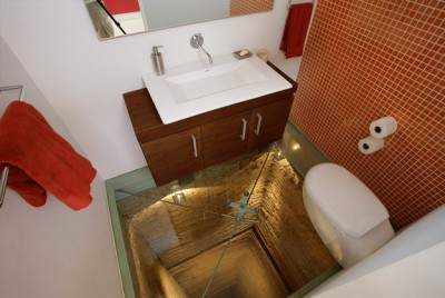 Interesting Designs: The Infinite Bathroom This neat design incorporates a bathroom with a view of an elevator shaft below. It's terrifying if you hate heights.