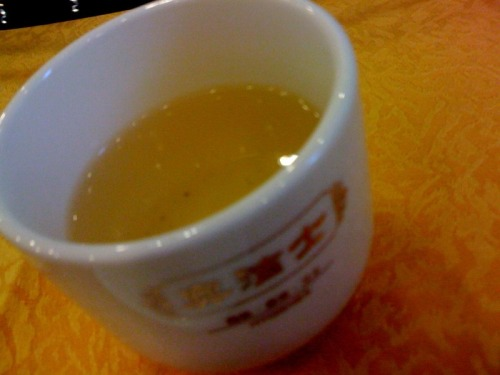 "Drinking Xian Zhi green tea 仙枝绿茶 from Wuyuan, Jiangxi 江西婺源(one of China's distinctive tea growing regions) at the Nanchang Restaurant in the Jiangxi Provincial Government's offices in Beijing. One of Tony's friends had a birthday lunch there yesterday and I was called upon to order the tea for the group.  I asked the server if they had any tea from Jiangxi (knowing that Wuyuan, Jiangxi is a famous tea producing region having visited there in 2009).  She said they did (even though tea selections from Jiangxi are not on their printed menu!), so of course that was what we ordered. It was nice. Soft, subtle, sweet and mellow.  Look forward to learning more about 仙枝绿茶 Xian Zhi (loosely translated as ""immortal branch/twig"") green tea! (sorry the photos aren't so great—using my cellphone) _____________________________________________________________________ If you enjoyed this article, sign up for Tranquil Tuesdays' newsletter to  Explore the stories behind each of Tranquil Tuesdays teas and teaware Travel with Tranquil Tuesdays seeking the best teas and teaware in China Learn the historical and cultural elements that make Chinese tea and teaware so unique Sign up for Tranquil Tuesdays' newsletter now!"