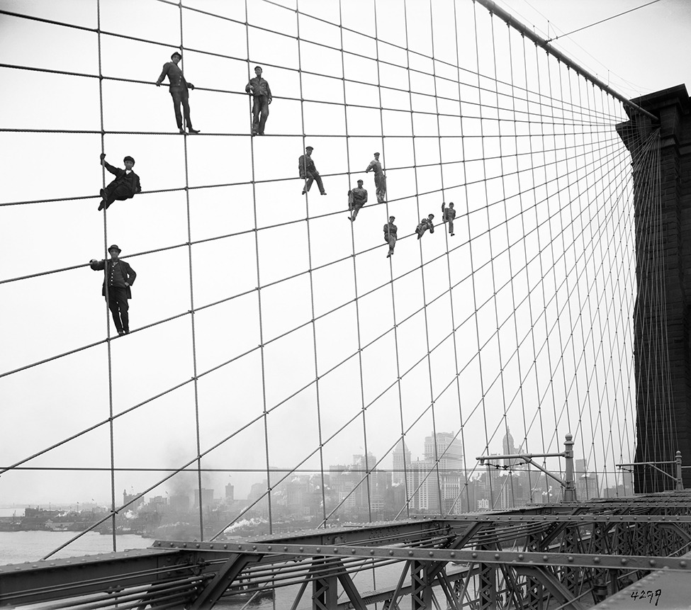 smithsonianmag:    Just Some Painters Hanging Out on the Brooklyn Bridge…No Big Deal  …the photographer was Eugene de Salignac, a municipal worker who took 20,000 photographs of modern Manhattan in the making.  Photo: Painters are suspended from wires on the Brooklyn Bridge in New York on October 7, 1914. AP Photo/New York City Municipal Archives, Department of Bridges/Plant & Structures, Eugene de Salignac  The Smithsonian's Retina blog is pretty awesome.