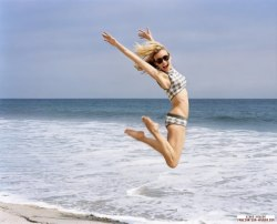 Diane Kruger - jumping at the beach