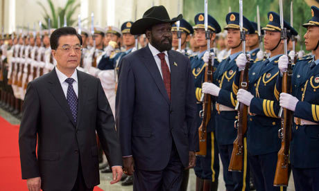 "South Sudan president says attacks amount to declaration war Salva Kiir's appeal to Beijing follows Sudan's bombing of market and oilfield The president of newly independent South Sudan has told China's president that attacks by rival Sudan amount to a declaration of war on his country.  There has yet to be a formal declaration of war by either of the Sudans, and Salva Kiir's remark, made in Beijing during talks with Hu Jintaoon Tuesday, signals a ratcheting up of rhetoric between the rival nations, which have been teetering on the brink of war. Kiir told Hu his visit comes at ""a very critical moment for the Republic of South Sudan because our neighbour in Khartoum has declared war on the Republic of South Sudan"". South Sudan became independent last year. The countries have since been unable to resolve disputes over sharing oil revenue and determining a border. Talks broke down this month. On Monday, Sudanese warplanes bombed a market and an oilfield in South Sudan, killing at least two people after Sudanese ground forces had reportedly crossed into South Sudan with tanks and artillery. South Sudan reported on Tuesday that eight more bombs had dropped overnight. The Sudanese president, Omar al-Bashir, has vowed to press ahead with his military campaign until all southern troops or affiliated forces are chased out of the north. China's energy needs make it deeply interested in the future of the two Sudans, with Beijing uniquely positioned to exert influence in the conflict given its trade ties with the resource-rich south and decades-long diplomatic ties with Sudan's government in the north. Pictured: South Sudan's President Salva Kiir with China's President Hu Jintao at a welcoming ceremony in Beijing, China. Photograph: Adrian Bradshaw/EPA"