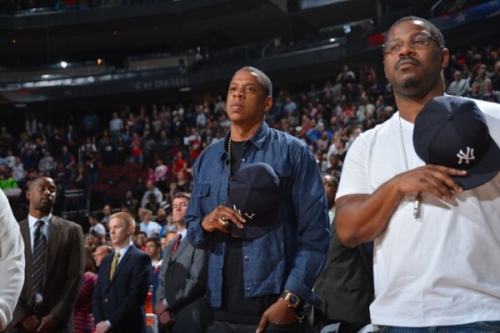 aintnojigga:  Jay-Z stands for the National Anthem at the New Jersey Nets game last night.