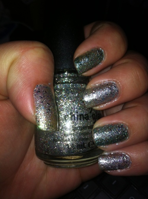 China Glaze's new Prismatic collection!! Chrome glitter extravaganza! I got Ray-Diant (thumb), Polarized (middle and pinky fingers), and Optical Illusion (pointer and ring fingers) The other three I have not purchased are Liquid Crystal, Prism, and Full Spectrum. Initially I thought Ray-Diant and Polarized were the same. They look the same in the bottle. Polarized however is much more silver than Ray-Diant that has a more clear base. Optical Illusion has a blue base and has the same minute and round glitters as the other two mentioned. Liquid Crystal has a darker blue base than Optical Illusion. Prism is a light lavender base, and Full Spectrum has a pale lavender base. All of them are of course glitterfied!