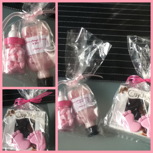 This is an absolutely gorgeous idea for a baby shower! Candy in a baby bottle along with beautiful pink moisturizing lotion as gifts for your guests! The small lotion bottle is a rinsed out Listerine bottle, filled with the lotion. How simple! For prizes, a box of chocolate with cute little baby feet erasers are just perfect! The Candy, Baby Bottle and Eraser were purchased from The Baby Shower Shop in Willetton, Western Australia. Special thanks to Kelly B for sharing her work with us!