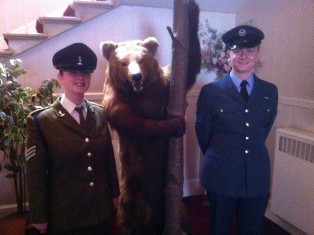 Warwickshire Bear Meets Lord Lieutenant's Cadets 2 cadets taking CVQO-led BTECs were appointed Lord Lieutenant cadets for Warwickshire last night at a ceremony in historic Warwick; receiving their coveted badges and certificates from HMLL Mr Martin Dunne JP. Congratulations to SSgt Jenny Thrower-Menzies of Warwickshire & West Midlands South ACF – Rugby Detachment and Sgt Michael Hadley of 121 (Nuneaton) Squadron, Warwickshire and Birmingham Wing ATC. Jenny passed her CVQO BTEC Diploma in Public Services last year with Distinction Star in November 2011 and Michael is halfway through his BTEC Public Services. Well done both.
