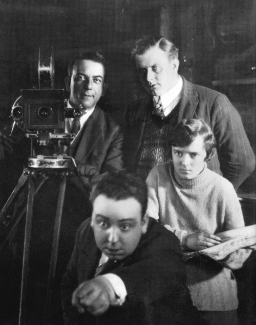 A young Alfred Hitchcock on the set of The Mountain Eagle (1926). Alma reville, his future wife, is at his side. (Via)