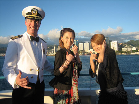 Mr. Captain clearly isn't sure what those cute Japanese girls want him to do XD