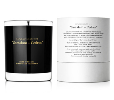 "Saturdays Surf NYC x Baxter of California ""Santalum + Cedrus"" Soy Wax Candle The latest from Baxter of California sees the lifestyle brand joining New York's Saturdays Surf NYC to curate a scented soy wax candle that is being touted as the, ""Santalum + Cedrus."" The collaborative scent takes on an aroma that fuses sandalwood and cedarwood to draw out earthy and somber notes. The fragrance is housed within a custom glass vase that is emblazoned with the trademark Saturdays Surf NYC ""slash"" logo. Priced at $30 USD, the Santalum + Cedrus burns for an estimated 60 hours and will be offered through Saturdays' shops as well as in the Los Angeles-based Baxter barbershop."