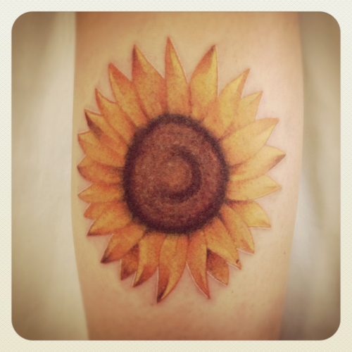 Sunflower tattoo by Aaron Wheatland