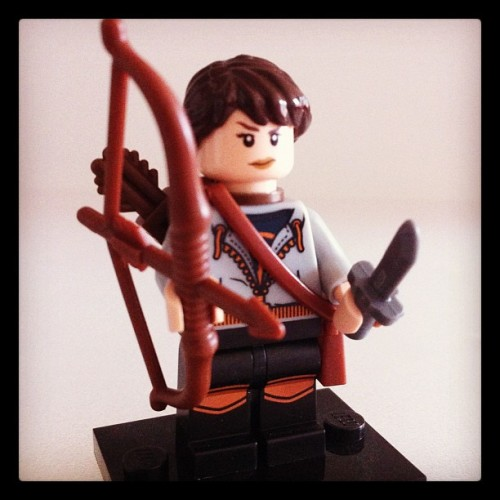 LEGO Katniss Everdeen (from The Hunger Games) And yes, the hair is braided at the back.