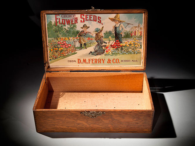 "D.M. Ferry & Co. Seed Box, c. 1890s This week's Smithsonian Snapshot celebrates National Garden Month with this antique seed box from Smithsonian Gardens. In the 19th century, seed packets were often displayed in wooden boxes adorned with colorful seed company labels. These boxes displayed several rows of seed packets separated by wooden dividers and were placed on general store countertops, acting as a ""silent salesman."" This late-1800s seed box displays the label for D.M. Ferry & Co., the seed company credited with inventing the ""commission box,"" a rack used for retail display. This seed box marks an important trend in advertising and marketing during the 19th century. It was acquired by the Smithsonian in 1986. Seed boxes were just one of many marketing tools used by seed companies to sell their products. They distributed catalogs to amateur gardeners each winter in preparation for spring gardening. There are more than 10,000 seed trade catalogs in the Smithsonian's collection. To view examples of these catalogs, visit the Smithsonian Institution Libraries website. This item is one of 137 million artifacts, works of art and specimens in the Smithsonian's collections. It is not currently on display. To learn more about this item, visit the Smithsonian Gardens website."
