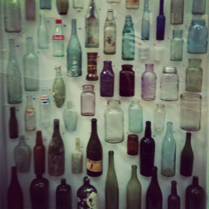 Glass Bottles (Taken with instagram) A collection of vintage glass bottles in a cabinet at the Western Australian Museum.