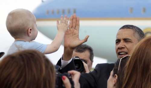 "yahoopolitics:  President Barack Obama arrives at at Buckley Air Force Base, Tuesday, April 24, 2012, in Aurora, Colo. (Carolyn Kaster/AP) Welcome to our new feature (that by Tumblr necessity must end with a question mark): ""What would you caption this photo?"""