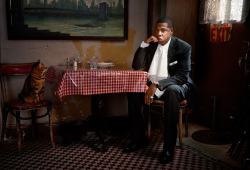 "This is a great photo of Jay-Z eating dinner with a cat that looks like a tiger.  cheatsheet:  jessbennett:  onetinyhand:  jay z.   yesss  Hov. Related: Bey named ""Most Beautiful"" by People Magazine."