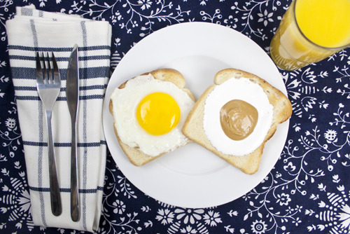 Peanut Butter Sunny-side Up  Two pieces of white breakfast toast, one topped with an egg sunny-side up and the other with a marshmallow fluff and Smooth Operator peanut butter center sunny-side up. Conceived By Lee ZalbenPhotography By Dina HorowitzBread By Orwasher's
